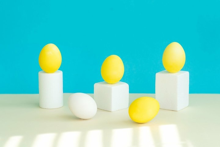 On geometric figures, as on a pedestal,there are yellow eggs