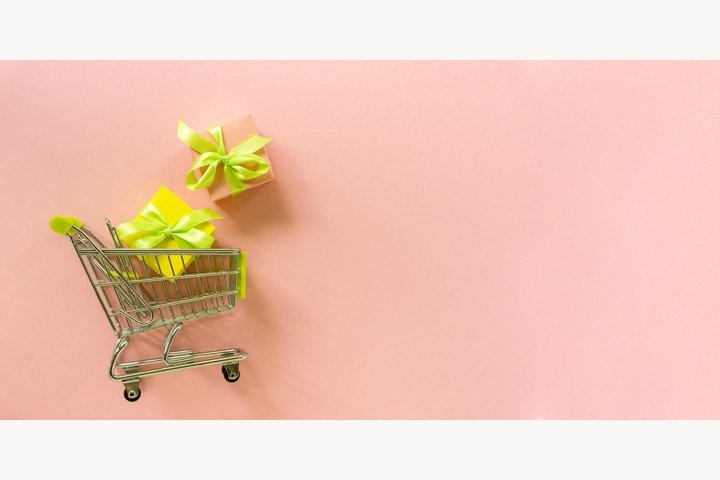 Shopping cart with multicolored gift boxes