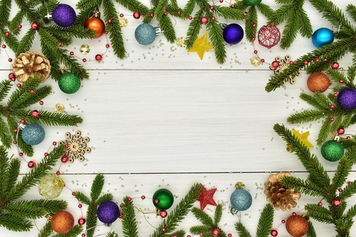 Christmas decorations on white wooden boards.