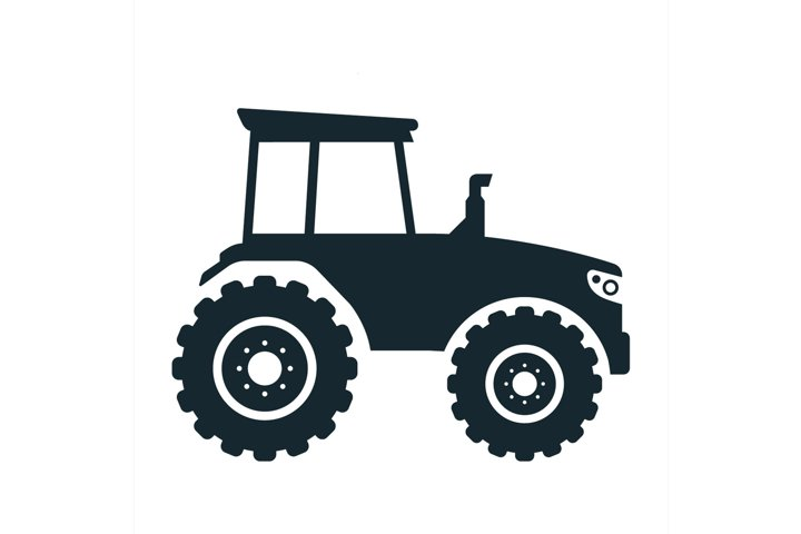 silhouette of a large agricultural tractor
