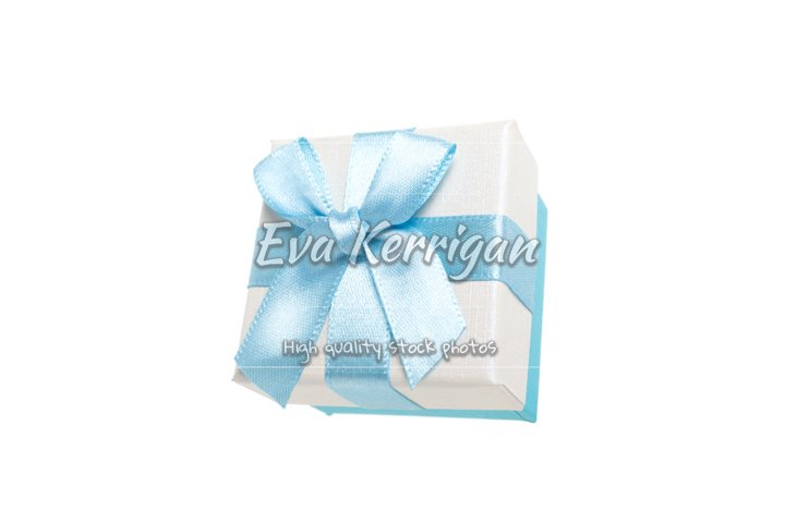 Gift box with a bow for rings in a delicate color of blue.