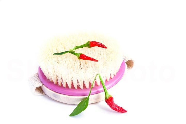 Body brush and pepper on white background