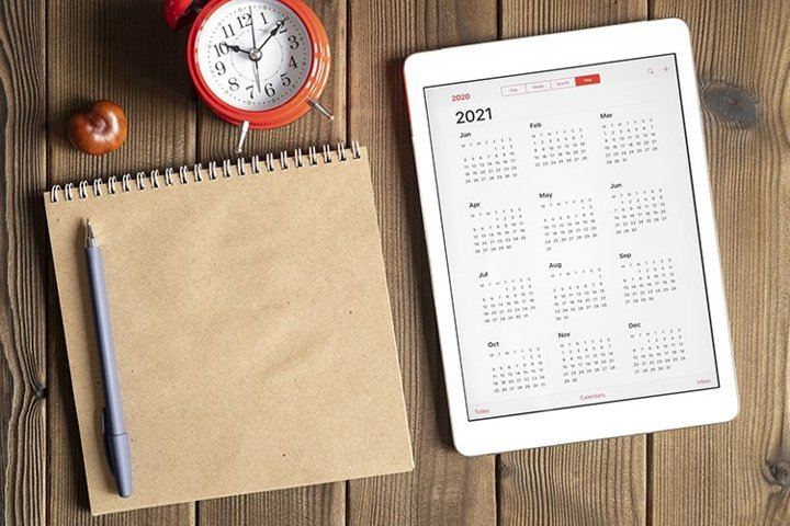 tablet with calendar for 2021, clock, notebook, copy space