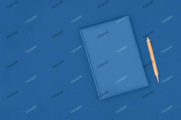 Notebook and pen on blue background. Business concept.