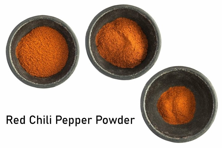 Red Chili Pepper Powder Heap in Black Iron Bowl Top View