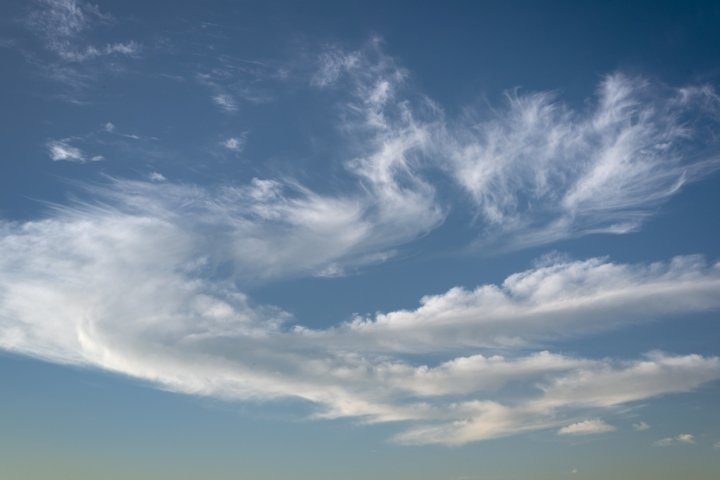 Blue sky with white clouds. Abstract background