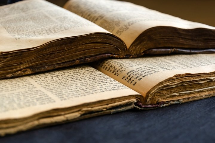 Jewish Bible. Open old Jewish books. Opened scripture pages