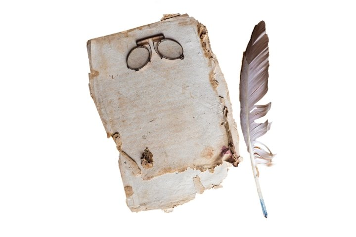 aged sheet of paper with vintage glasses and ink feather pen