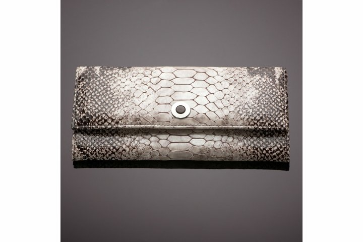 Womens wallet made of crocodile skin on a brown background