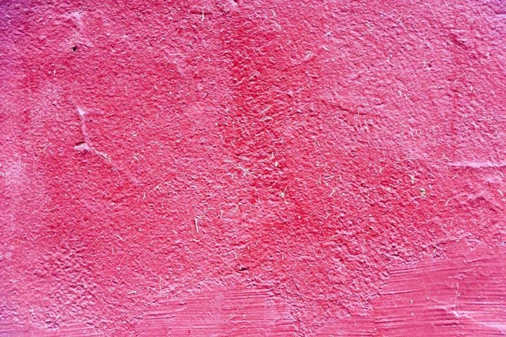Grunge red wall background texture. Close up macro.