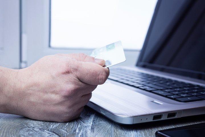 Bank card laptop businessman
