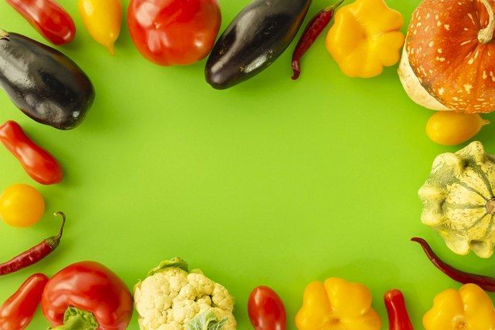 Decorative frames of vegetables on colored background