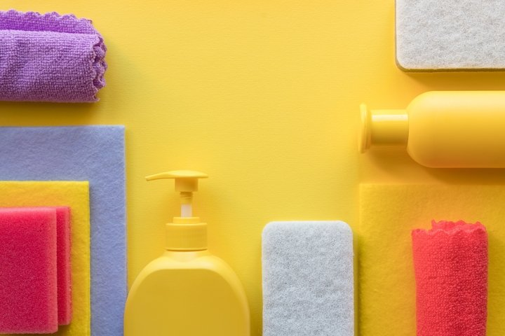 flat lay with cleaning products on yellow background