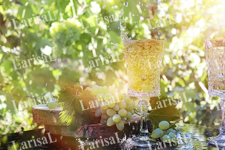 White grapes, crystal glass, young wine, sunlight.