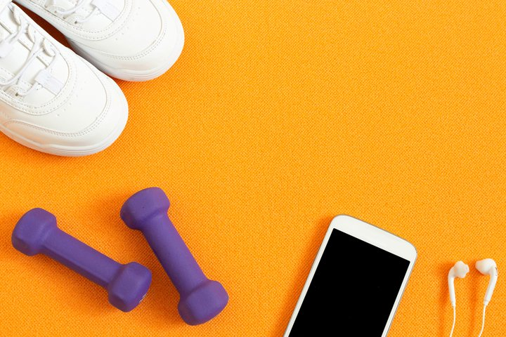 Sneakers, dumbbells, smartphone with headphones