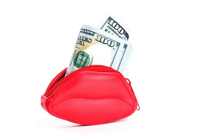 Red purse in the form of lips and banknotes of dollars