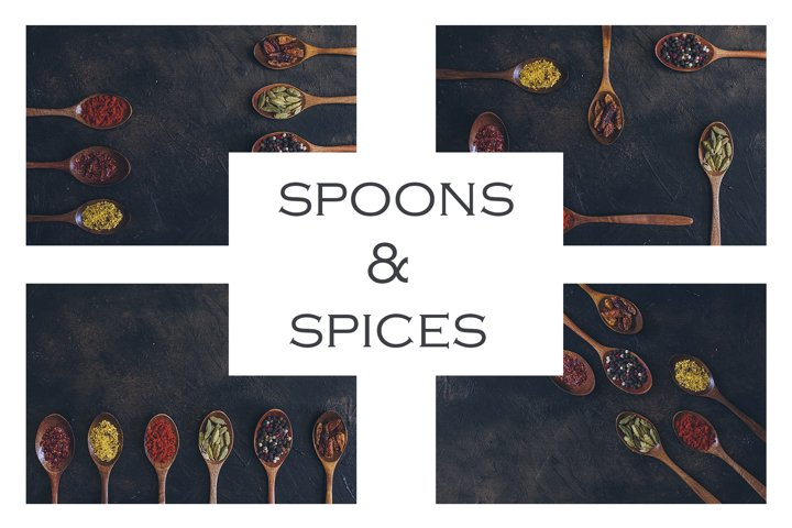 Colorful various spices in wooden spoons on old dark
