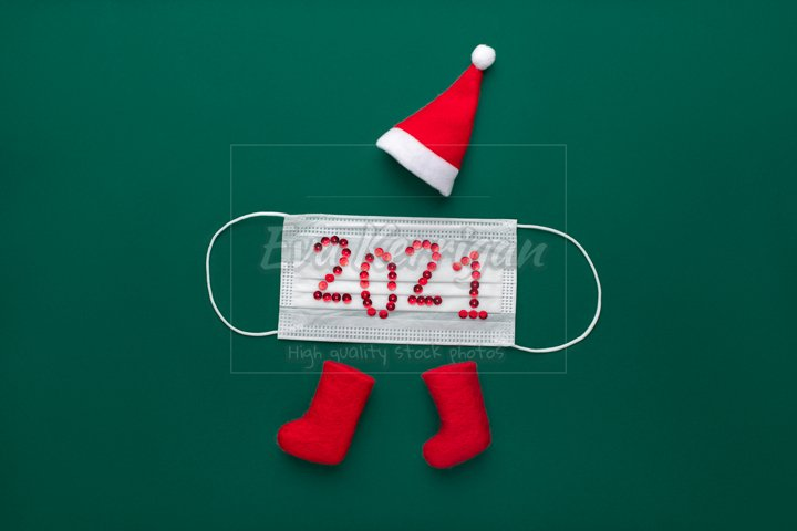 Concept new year 2021 christmas. Santa claus hat and mask.