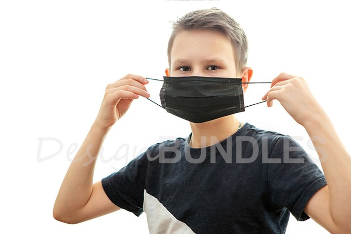 A boy puts on a black antibacterial mask, white background.