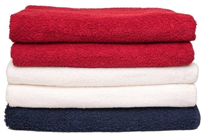 Stack of neatly folded clean soft bath towels after laundry