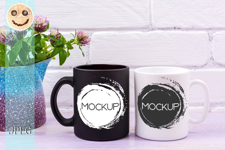 White and black mug mockup with pink clover