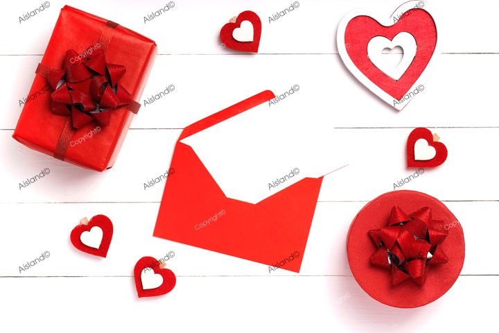 Valentines Day composition. Heart, gift, envelope on white