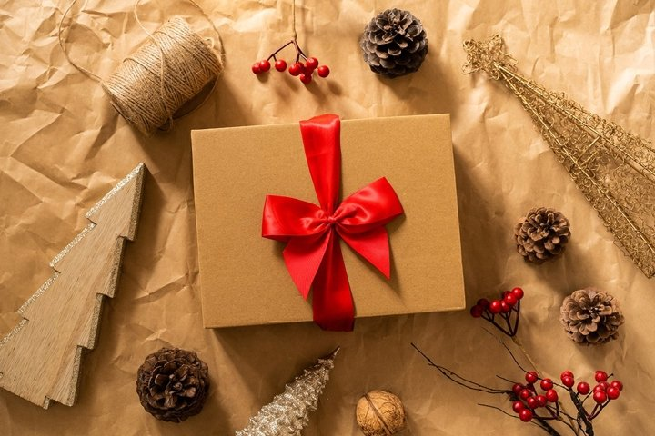 Gift box and Christmas decor on craft paper background