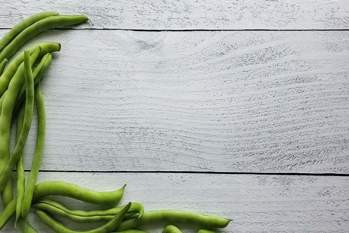 Stock Photo of Fresh Green Beans on a Light Wood Background