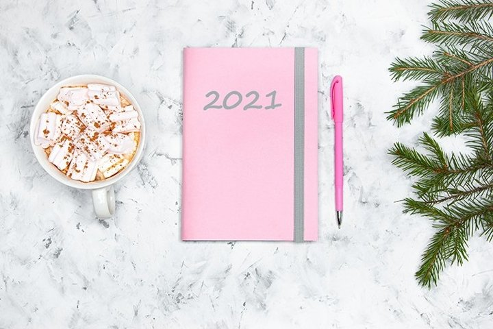 Pink note book and coffee with marshmallows.