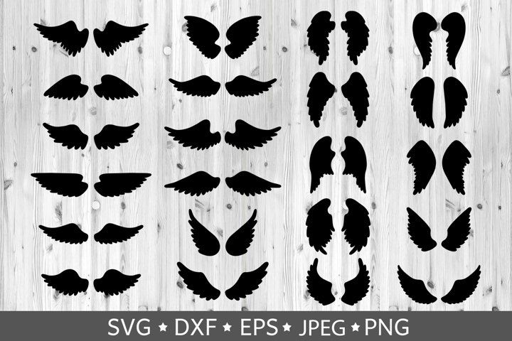 Set of hand drawn angel or bird wings silhouettes. Vector.