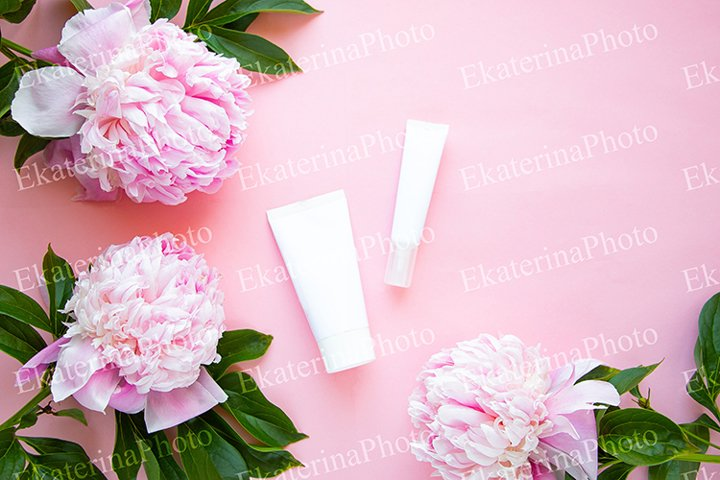 Peonies and cosmetic tubes.