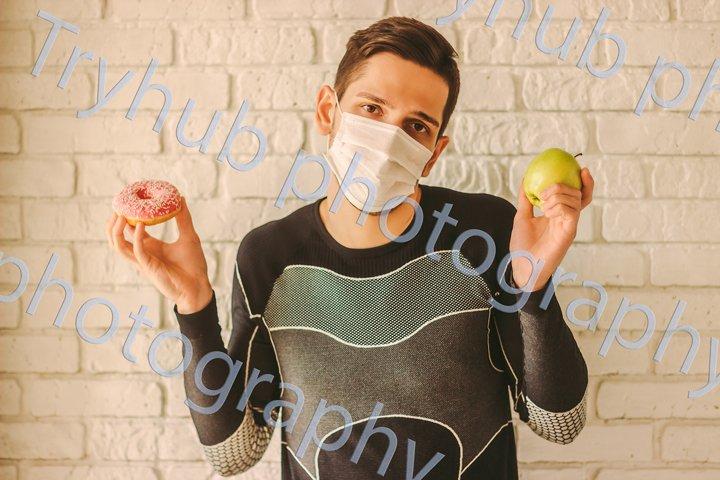 Deciding between apple or sugar donut at home quarantine