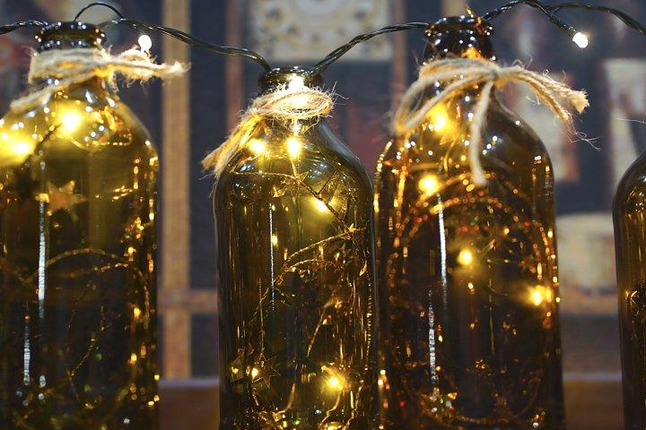 Garland burns inside dark glass bottles