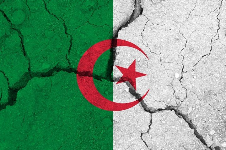 Algeria flag on the cracked earth