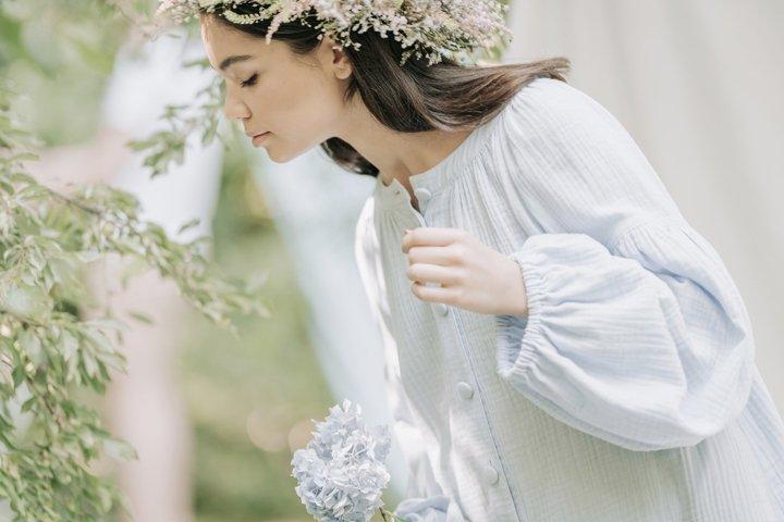 tender girl holding a plant
