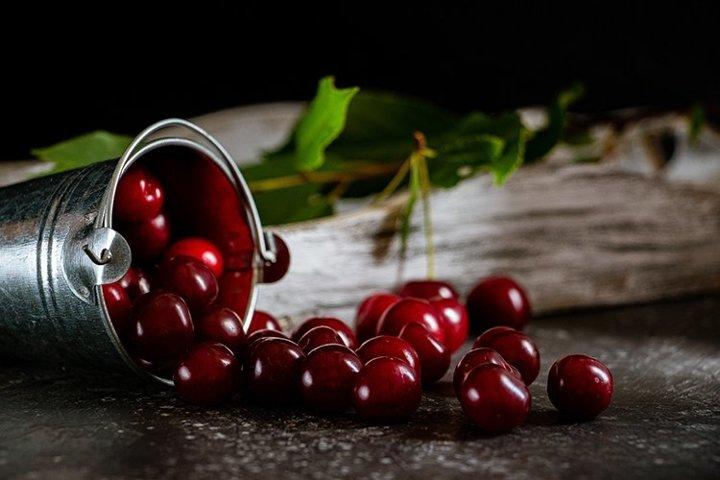 Still life. Cherries on a dark background.