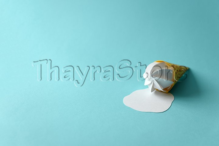 Melted paper vanilla ice-cream cone on blue background.