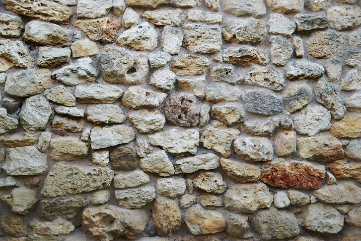 Old yellow stone wall texture from ancient bricks