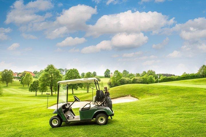 Golf cart green grass field. Golf club