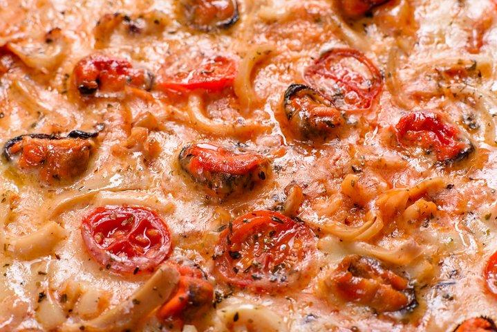Seafood Italian pizza with shrimp. 5 photos