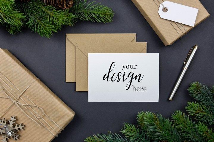 Christmas greeting cards, envelopes mockups, flat lay. PSD.