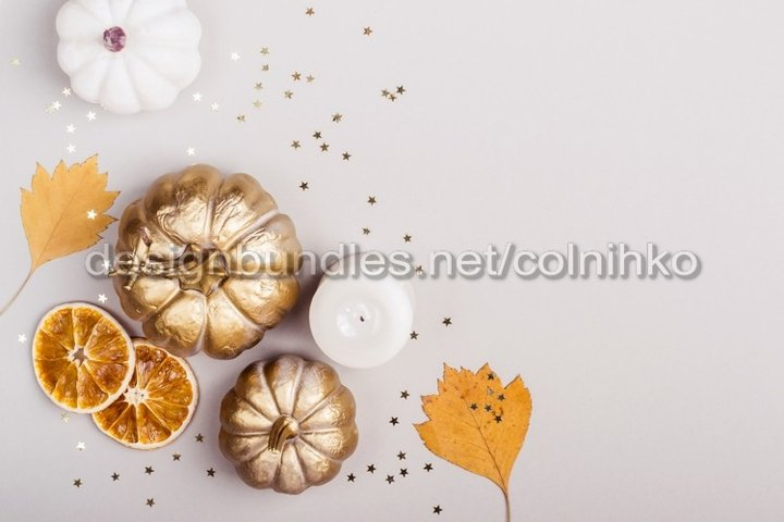Multicolored leaves and white pumpkins