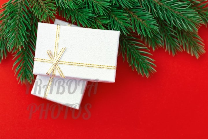 Christmas background with gift boxes on red