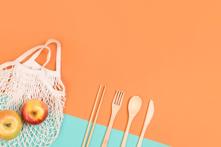 Reusable wooden cutlery and grocery bag.
