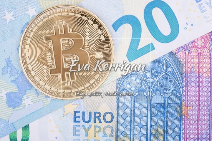 Bitcoin gold coin lies on paper euro, top view.
