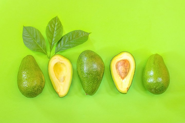 Fresh avocados. Background with avocado.