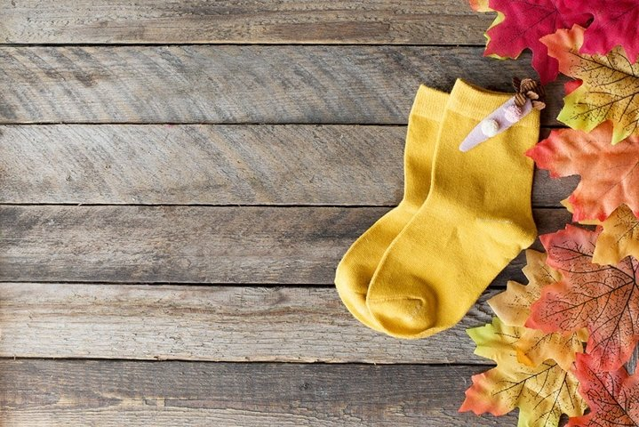 childrens yellow knitted socks with red autumn leaves