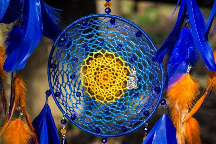 Dreamcatcher made of feathers leather beads and ropes