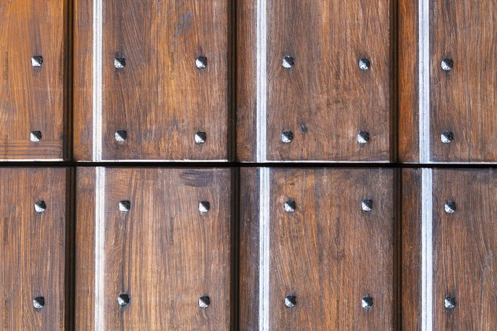 Seamless texture of grungy wooden wall or door