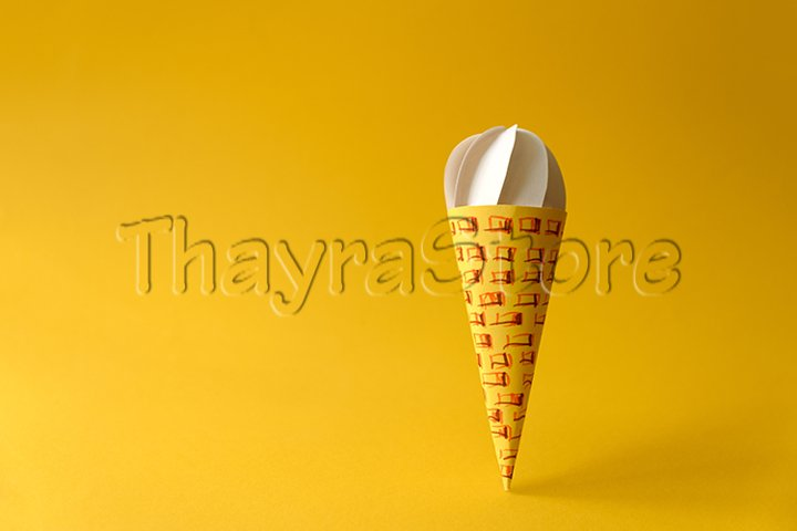Paper vanilla ice-cream cone on yellow background.